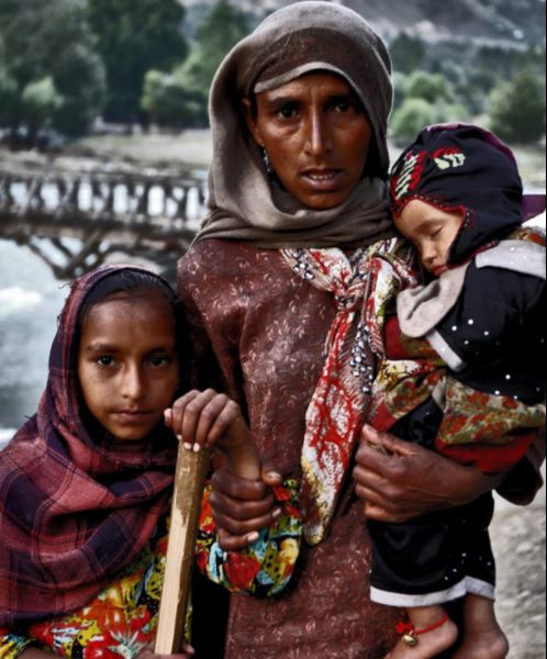 A Bakarwal woman with her daughter and son